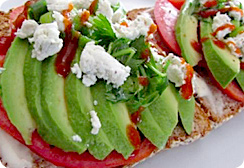 Sliced Avocado and Tomato on Toasted Ezekiel