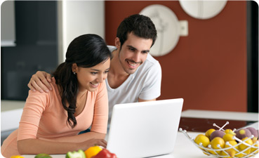 Man and woman looking up dinner ideas