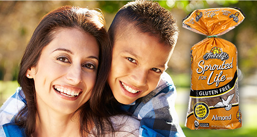 Mother and child smiling with Sprouted for Life bread